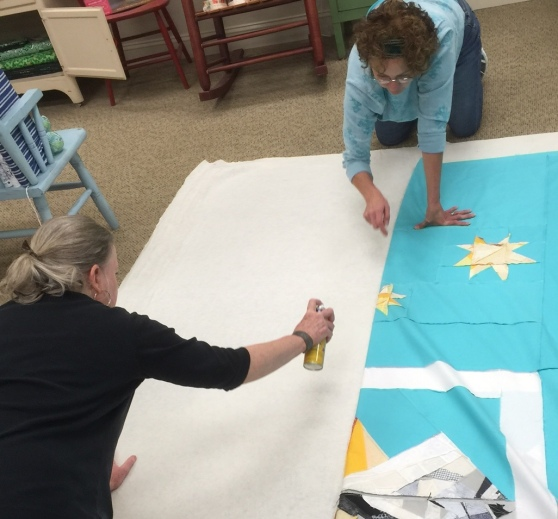 Terry & Janelle Getting the Quilt Ready for our brave new long arm quilter, Randy Case!